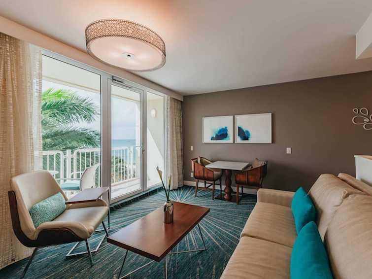 Lounge area of Ocean Suite at Aruba Renaissance Resort & Casino. Photo Credit: ©Marriott International.