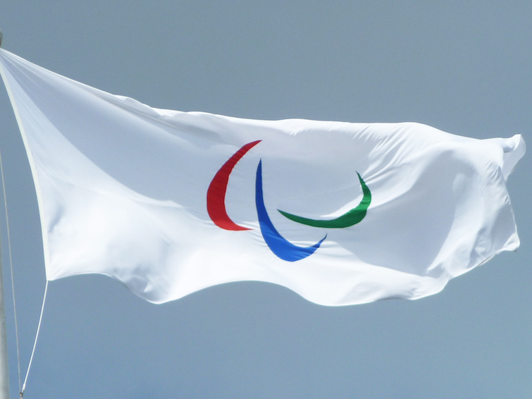 Paralympic Games Flag with three Agitos. Photo Credit: © David Pearson for Government Olympic Communication via Wikimedia Commons.