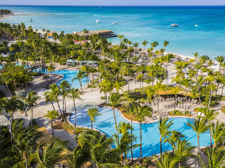 View of pool and beach at Hilton Aruba Caribbean Resort & Casino. Photo Credit: © Hilton Aruba Caribbean Resort & Casino.